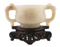 A Qing period pale celadon jade two- handled censer is estimated at 800-1,200.