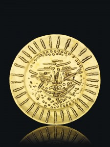 Pablo Picasso (1881-1973) - VISAGE TOURMENTÉ 22 carat gold repoussé plate Diameter: 16 3/8 in.  Courtesy Christie's Images Lt.d, 2013.  (Click to enlarge).