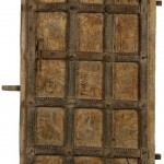A CARVED WOODEN INDIAN DOOR, 17th/18th century, profusely decorated with fifteen unique panels (1,800-2,500).