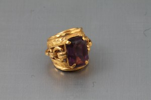 A heavy gold ring set with an amethyst (1,000-1,400).