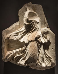 A c Ist century A.D.  Roman relief of a Bacchante or Maenad at Rupert Wace Ancient Art Ltd.