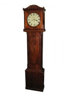 An early 19th century Cork longcase clock (1,500-2,500).