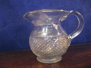 An early 19th century Irish cut glass jug (400-800).