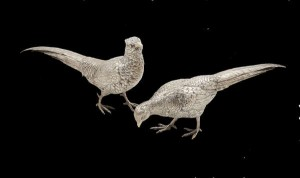 A pair of 19th century Dutch silver pheasants, city of Voorschoten, mark of J. M. van Kempen & Zonen estimated at 1,500-2,500.