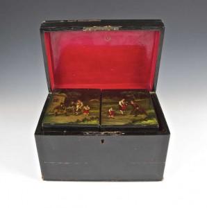 A 19th century Russian lacquered papier-mache tea caddy (1,200-1,800).