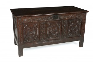 An 18th century oak chest (650-850).