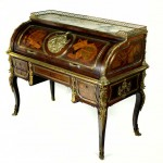 A French ormolu bureau a cylindre in the manner of Jean Henri Riesener madea hammer price of 7,600
