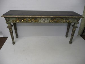 A pair of antique Italian painted and gilded side tables with slate tops (4,000-6,000).