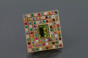A large multi stone ring (3,000-3,500).