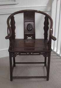 A 19th century Chinese hardwood armchair (100-200).