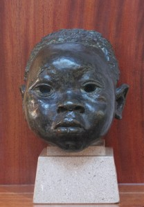 Sir Jacob Epstein (1880-1959) Head of a young Negro Boy, green patinated bronze (9,000-10,000)