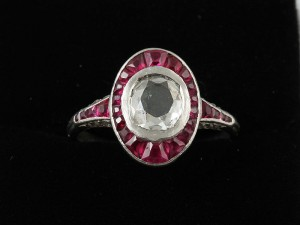 An early 20th century diamond and ruby ring (2,200-2,500).