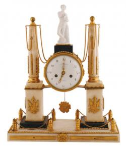An 18th century ormolu and marble clock (2,500-3,500).