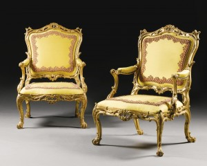 A PAIR OF GEORGE III GILTWOOD ARMCHAIRS CIRCA 1765, ATTRIBUTED TO WILLIAM GOMM (£150,000-200,000).