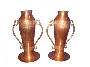 A pair of Irish Celtic Revival two-handled vases, stamped Youghal A.M.W. (1,000-2,000).