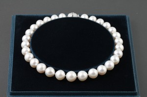 A South Sea Pearls necklace in Garrard case with diamond clip (15,000-16,000).