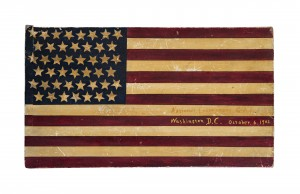 David A. Schorsch-Eileen M. Smiles American Antiques, Inc. Forty five star American National flag two-sided sign board. American, 1902. White pine, original painted decoration, and gold metallic paint. 14 in. x 24 in.