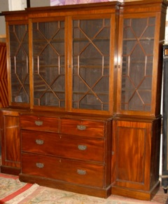 A four door breakfront Georgian bookcase is estimated at 2,000-3,000.