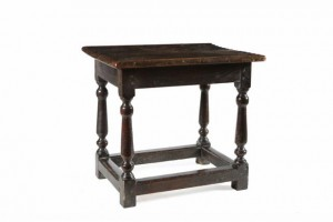 An 18th century oak stool (200-300).