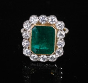 A yellow gold diamond and emerald ring  (3,000-5,000)