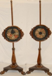 A pair of rosewood polescreens.