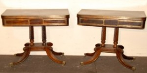 A pair of Regency foldover card tables.