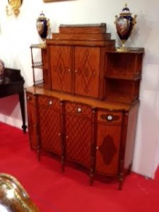 An exceptional late 19th century satinwood side cabinet with a design by Thomas Sheraton at Connaught Antiques.