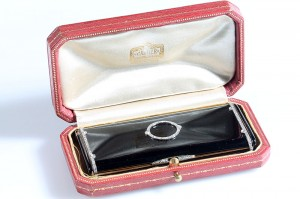 A c1930 black enamel and diamond set cigarette box by Cartier (8,000-12,000).