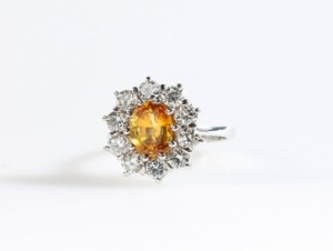 A diamond and yellow sapphire cluster ring (2,500-3,000).