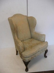 An antique wing back drawingroom chair (800-1,200).
