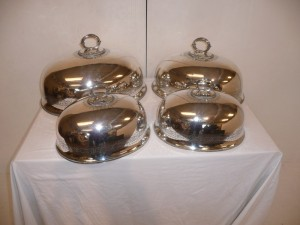 A set of four 19th century silver plated dish covers (300-500).