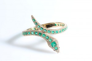 A 1960's diamond and emerald bangle in the form of a snake (20,000-30,000).