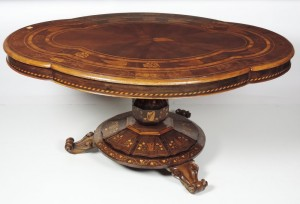 This large Killarney wood centre table is estimated at 15,000-20,000.