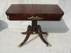 An Irish (Cork) mahogany brass mounted fold over card table c1800 sold for 1,950.