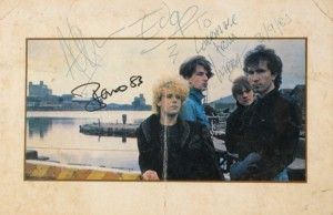 U2 - Promotional photographic card signed by Bono, The Edge, Adam Clayton and Larry Mullen, Jr. Dated 3 September 1983 (200-250)