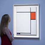 A Sotheby's employee admires Mondrian's Composition with Red, Blue and Grey