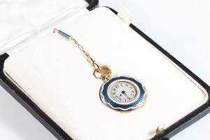 An antique enamelled fob watch (1,900-2,100).