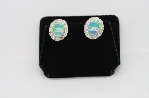 Opal and diamond cluster earrings, with harlequin opals (3,950).