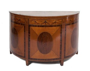 A FINE SATINWOOD, HAREWOOD AND ROSEWOOD CROSS BANDED SEMI ELLIPTICAL COMMODE, in George III style (2,000-4,000)