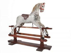 A LATE 19TH CENTURY DAPPLED GREY ROCKING HORSE (1,000-1,500)
