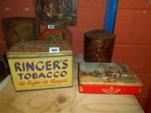 A quantity of vintage advertising tins