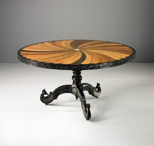 An Anglo-Indian Carved and Inlaid Rosewood, Ebony, Hardwood, Mahogany, Bone, and Ivory Parcel Gilt Circular Center Table Ceylon, circa 1830 ($40,000-60,000)