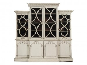A Fine George III White-Painted Breakfront Bookcase in the Manner of Mayhew and Ince Circa 1760 ($80,000-120,000).