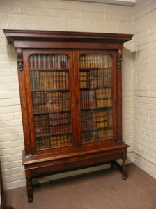 Antique bookshelves on a table base are estimated at 1,000-1,500
