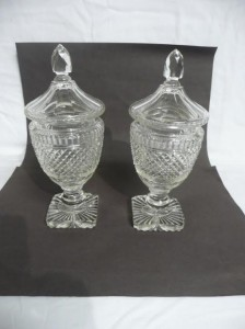 A pair of cut glass urns (100-200).