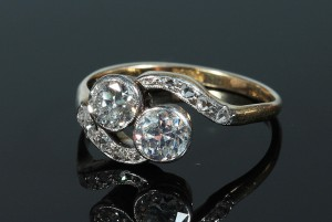 An antique two stone diamond ring (1,000-1,200).