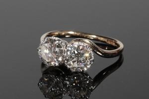 A twist design diamond ring (3,000-4,000).