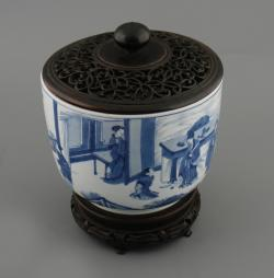 Kangxi blue and white bowl with pierced hardwood lid and carved stand (6,000-8,000).