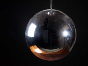 A Tom Dixon mirror globe light (200-300).