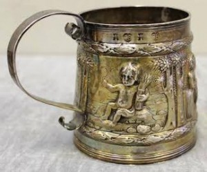 The mug by Charles Begheagle, repousse chased with children representing the Four Seasons.